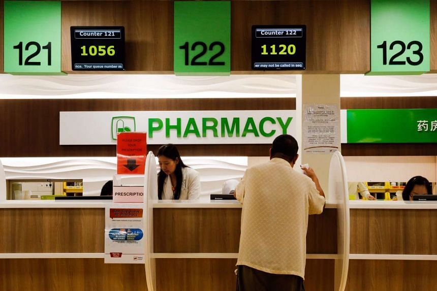 A patient collection his prescription at Marine Parade Polyclinic's pharmacy.