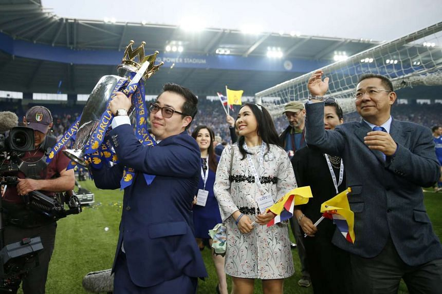 Leicester City Vice-Chairman Aiyawatt Srivaddhanaprabha (second from left) lifts the trophy as he celebrates with Chairman Vichai Srivaddhanaprabha after winning the Barclays Premier League.