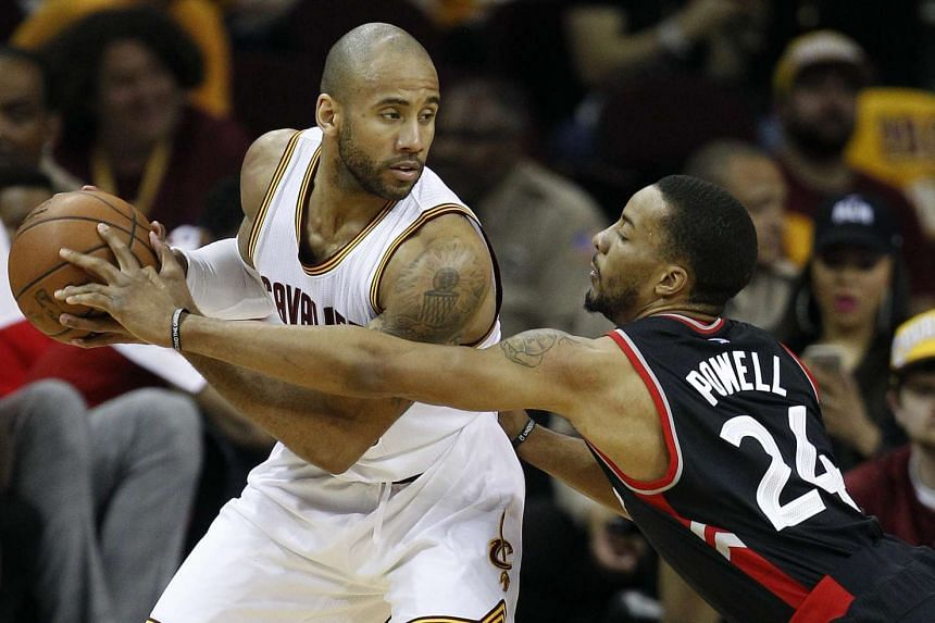 Toronto Raptors' Norman Powell (right) defends against Cleveland Cavaliers guard Dahntay Jones at the Quicken Loans Arena in Cleveland, Ohio on May 17, 2016.