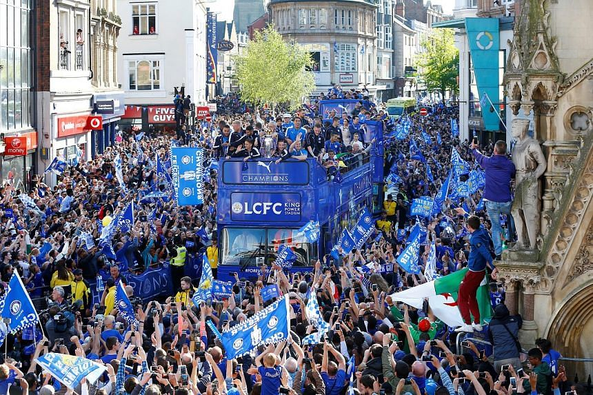 Leicester City celebrating with the trophy on the bus during the parade.