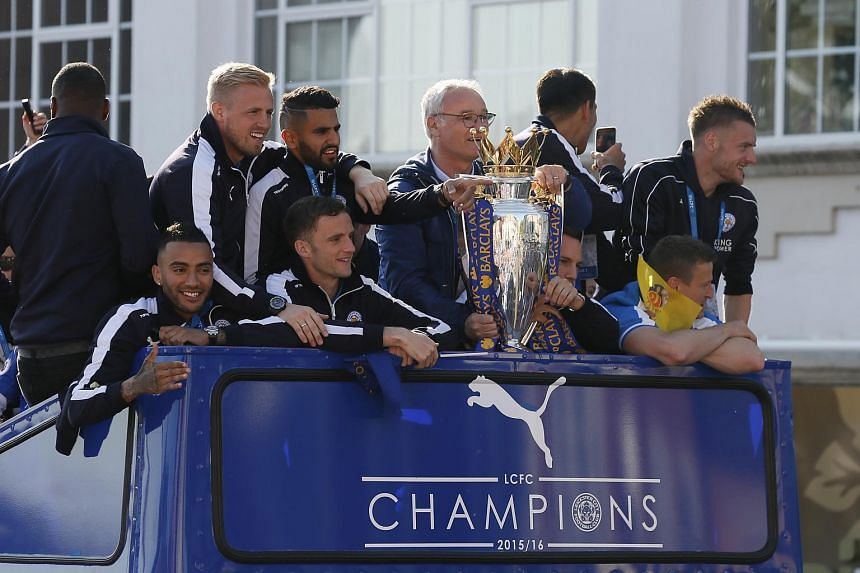 Leicester City manager Claudio Ranieri, Kasper Schmeichel, Riyad Mahrez, Andy King, Danny Simpson, Danny Drinkwater, Jamie Vardy and Robert Huth celebrating with the Premier League trophy during the parade.