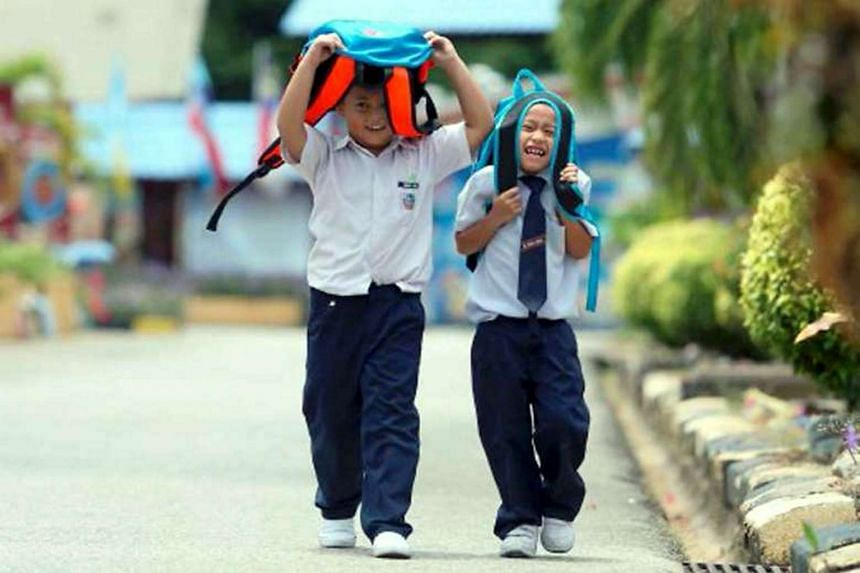 Pupils in Malaysia use their school bags to shelter from the sun as temperatures for April 2016 exceeded 37°C.