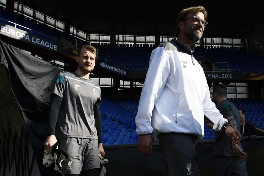 Liverpool manager Juergen Klopp (right) will hope his side can control the Europa League final in Sevilla's half with his trademark game plan of high-intensity pressing.