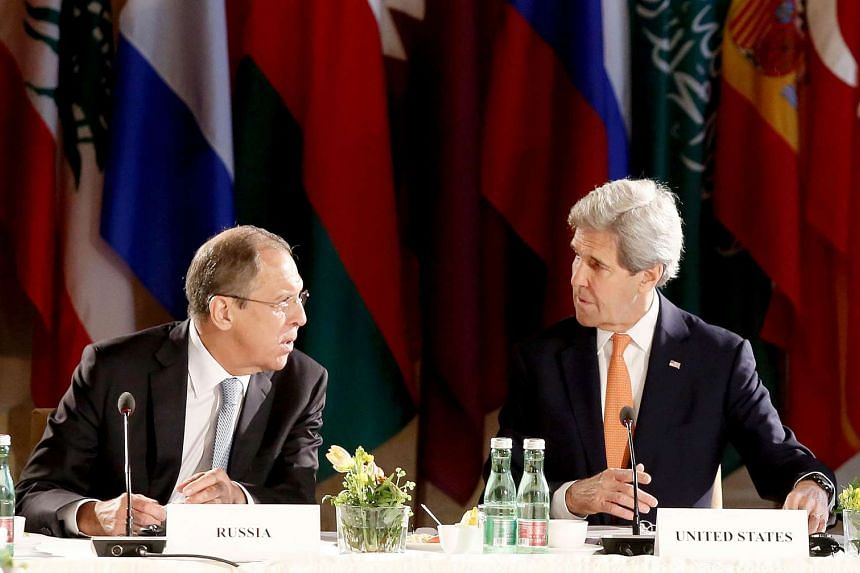 US Secretary of State John Kerry (right) chats with Russian Foreign Minister Sergei Lavrov at  talks on Syria on May 17, 2016 in Vienna.