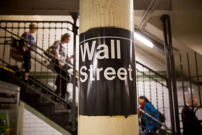 The Wall Street subway sign is seen in a station near the New York Stock Exchange.