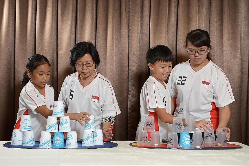 (From left) Shaina Nero Ruiz, Madam Phua Peck Ling, Edison Chew and Winnie Hiew are all champion cup stackers. Sport stacking, or cup stacking, is offered at various schools in Singapore as a co-curricular activity. It requires participants to stack