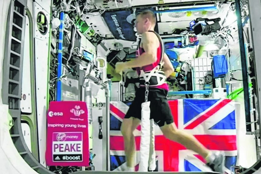 British astronaut Tim Peake (above) running on a treadmill aboard the International Space Station. He had used RunSocial, a software by Singapore fitness start-up Paofit, to help him train for this year's London Marathon.