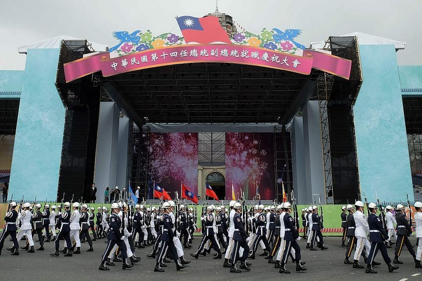 Honour guards rehearsing in front of the Presidential Palace in Taipei yesterday, ahead of Ms Tsai's inauguration tomorrow. The economy is likely to rank high on Ms Tsai's to-do list.