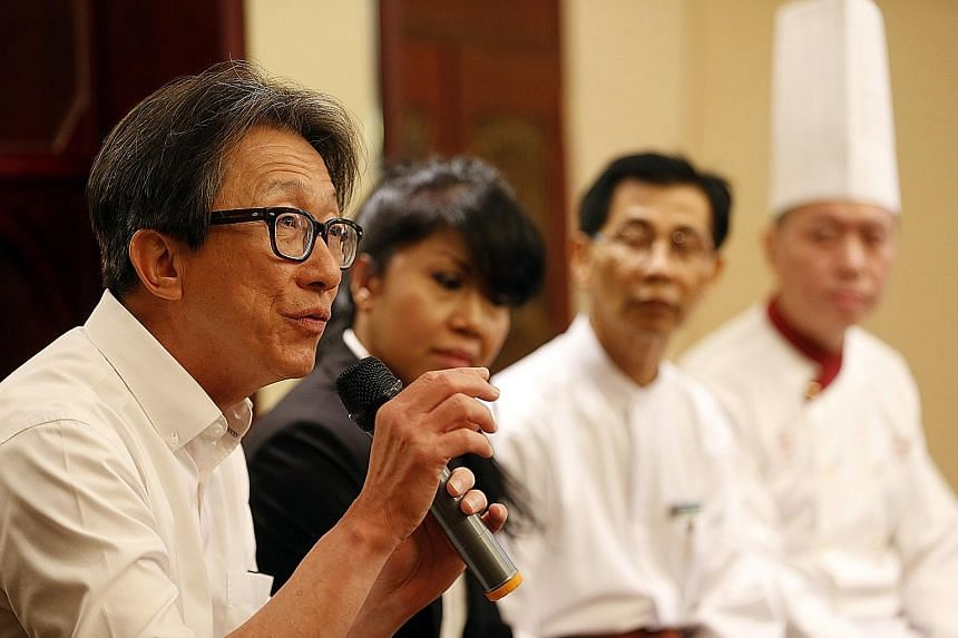 """Manpower Minister Lim Swee Say at restaurant Lawry's The Prime Rib yesterday. He praised it for being an """"early adopter"""" of job redesign for older workers, ahead of legislation to raise the re-employment age from 65 to 67 in July next year."""