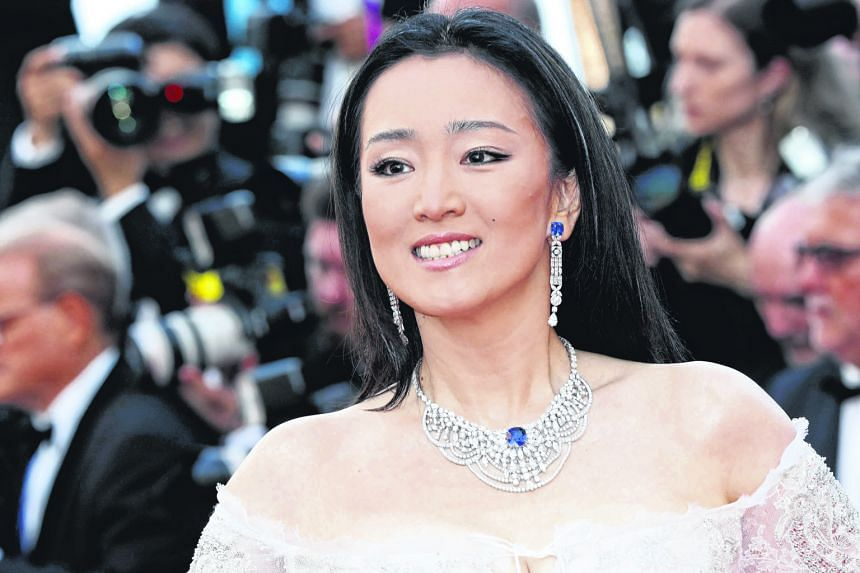 Chinese actress Gong Li with flawless skin at the Cannes Film Festival.