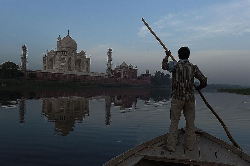 An Indian boatman on the Yamuna River behind the Taj Mahal on April 16. A petition over the pests at the monument was filed in the National Green Tribunal, an environmental court, last week.