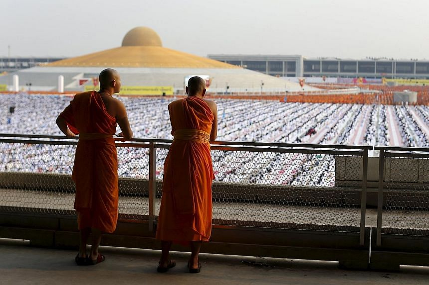 Buddhist monks and novices gathered to receive alms at the Dhammakaya temple last month. An arrest warrant was issued for its abbot, who has failed to report to police over accusations that he received illegal donations that had been embezzled from a