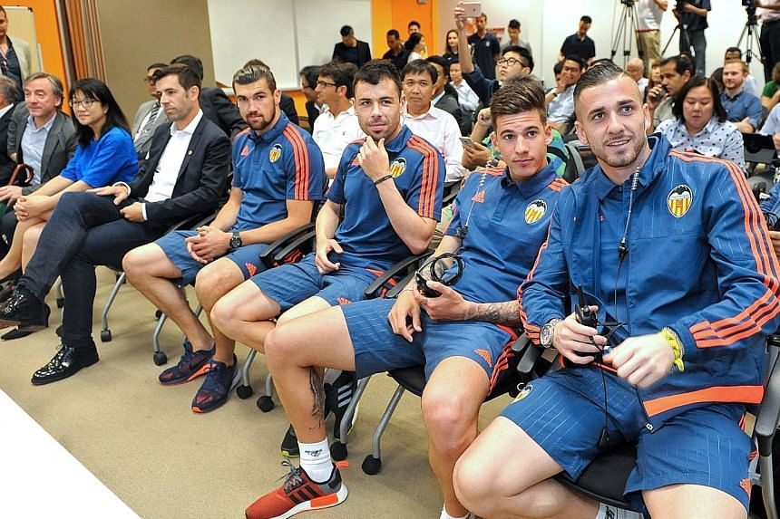 Valencia coach Pako Ayestaran and several first-team players are in town for a few days to do community work. They will also unveil plans for next year's full visit. At yesterday's press conference were (from right) goalkeeper Jaume Domenech, striker