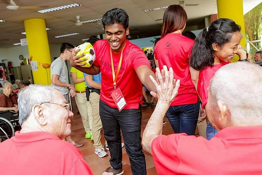 Onelyst's Mr Abbas (above) at a Youth Corps Singapore event. His business came about because he was exploring ideas for a start-up that could make a difference, and he knew something could be done to improve access to financial information for low-in
