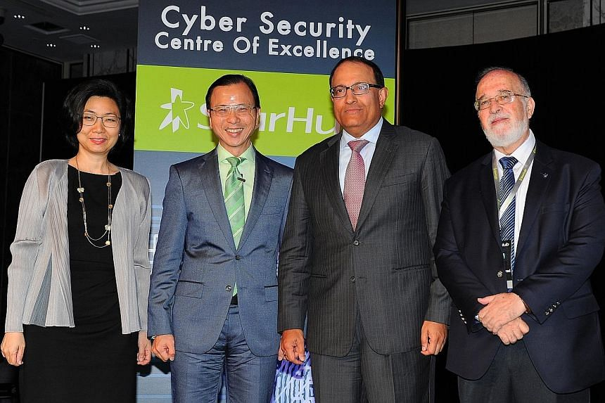 At the launch of the initiative yesterday were (from left): Economic Development Board assistant managing director, Ms Thien Kwee Eng; StarHub chief executive officer, Mr Tan; Minister for Trade and Industry (Industry), Mr Iswaran; and adviser, StarH