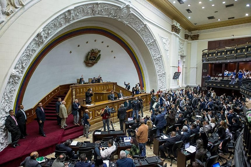 Legislators at the National Assembly in Caracas on Tuesday, when the opposition rejected Mr Maduro's emergency decree.