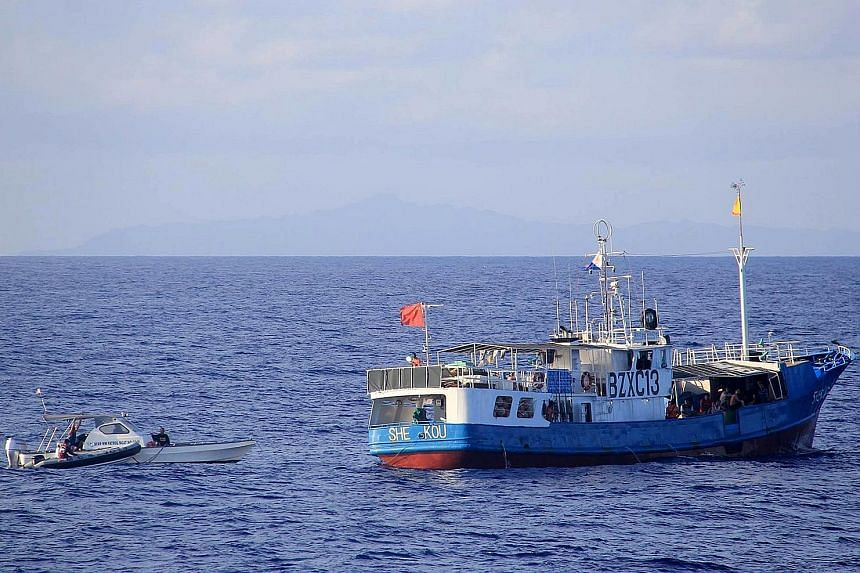 Philippine Coast Guard officers checking a Chinese vessel in the northern Balintang Channel this week. Manila has lodged a case with a UN court challenging China's claims in the South China Sea.