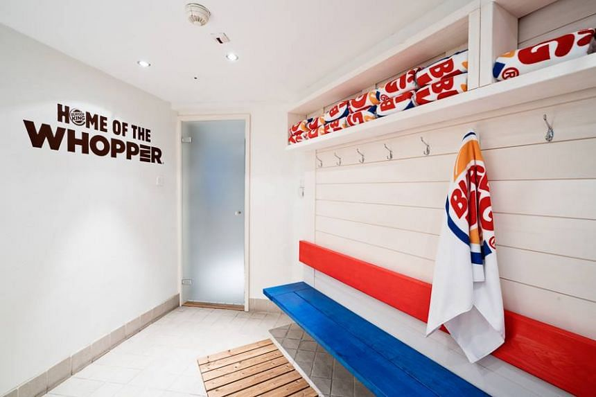 Burger King themed towels and robes are provided for lounging and the interior of the sauna follows the iconic red-and-blue colour scheme.