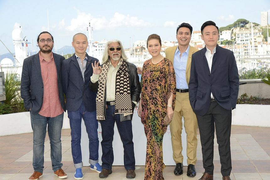 (From left) Fran Borgia and Raymond Phathanavirangoon, producers of Apprentice with director and cast at the photocall at the Cannes Film Festival.