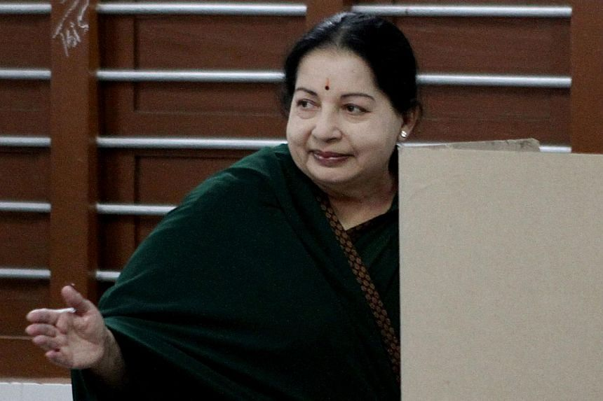Chief Minister of the southern Indian state of Tamil Nadu and All India Anna Dravida Munnetra Kazhagham party leader J.Jayalalitha gestures as she arrives to cast her vote at a polling station in Chennai on May 16, 2016.