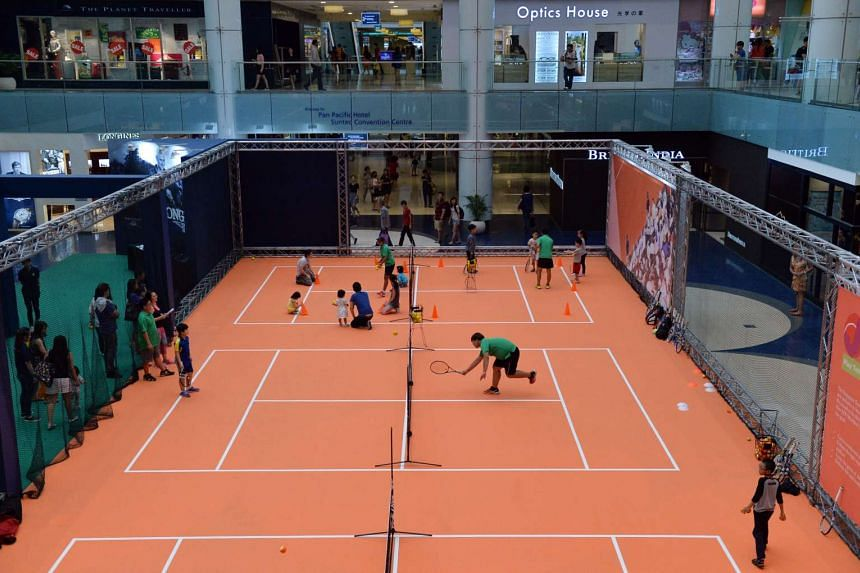 Children participating in tennis-related activities at Marina Square's central atrium on May 14, 2016.