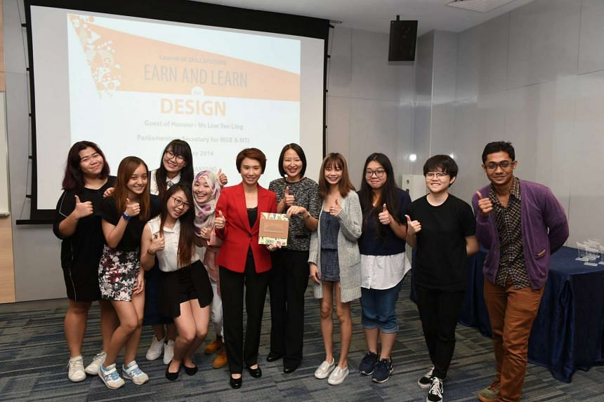 Ms Low Yen Ling, Parliamentary Secretary for Education and Trade and Industry, Ms Jeanne Liew, principal & CEO of Nanyang Polytechnic, with NYP graduates involved in the two new ELPs.