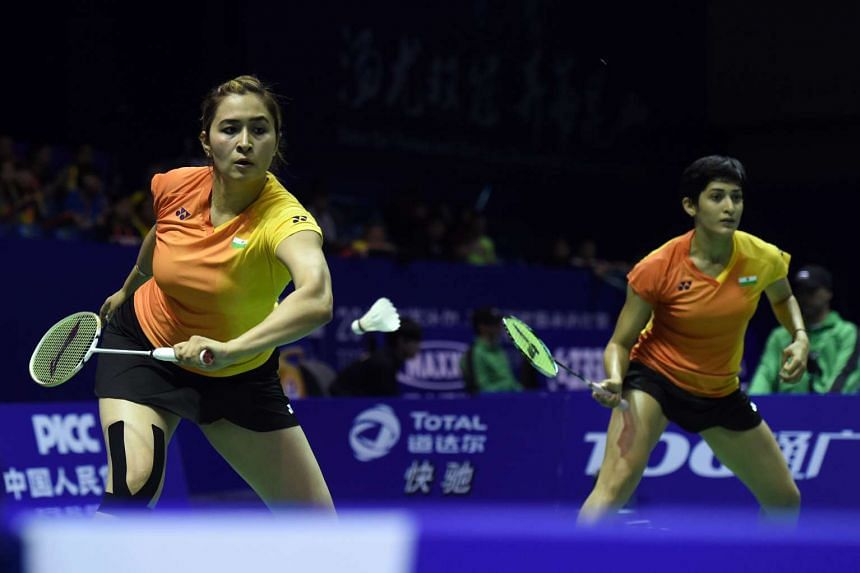 India's Gutta Jwala (left) and Aswini Ponnappa hit a return against their Thailand opponents during the Uber Cup, on May 19, 2016.