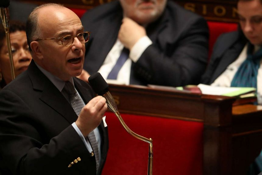 French Interior minister Bernard Cazeneuve speaks at a session of questions to the Government at the French National Assembly, on May 18, 2016, in Paris.
