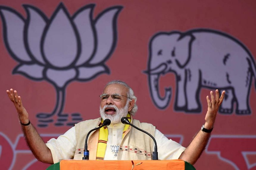 India's Prime Minister Narendra Modi addresses an election rally at Majuli Island on March 26, 2016, ahead of state assembly elections in Assam.