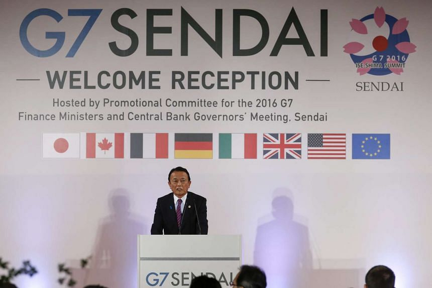 Japanese Finance Minister Taro Aso speaks at the welcoming reception of the G7 Finance Minister and Central Bank Governors meeting in Sendai, on May 19, 2016.