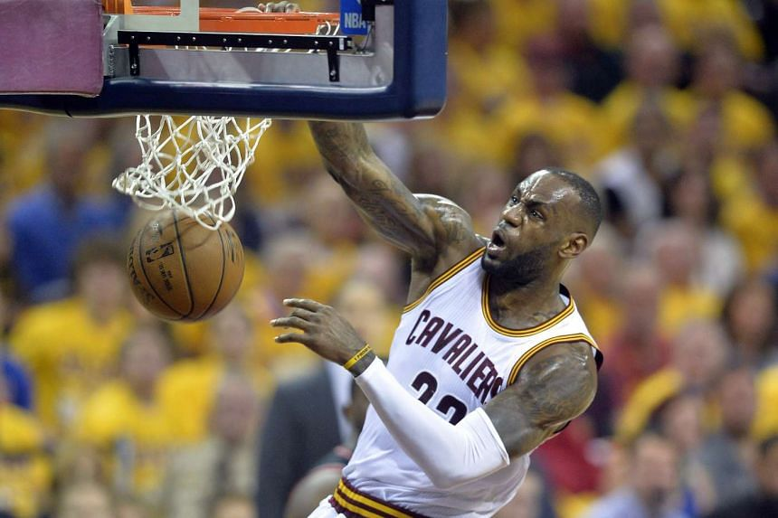 Cleveland Cavaliers forward LeBron James dunks in the second quarter against the Toronto Raptors in Game 1 of the Eastern conference finals, May 17, 2016.