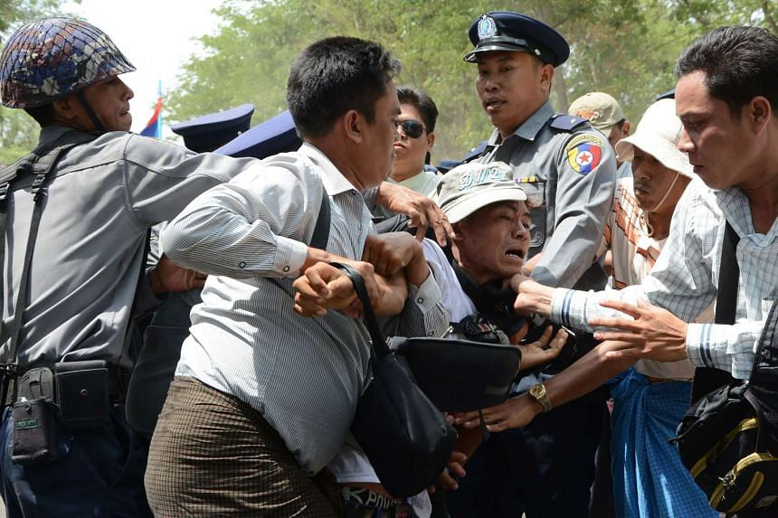 A demonstrator demanding labour rights is arrested by police in Tetkone township on May 18, 2016 during a workers protest march to central Naypyidaw.