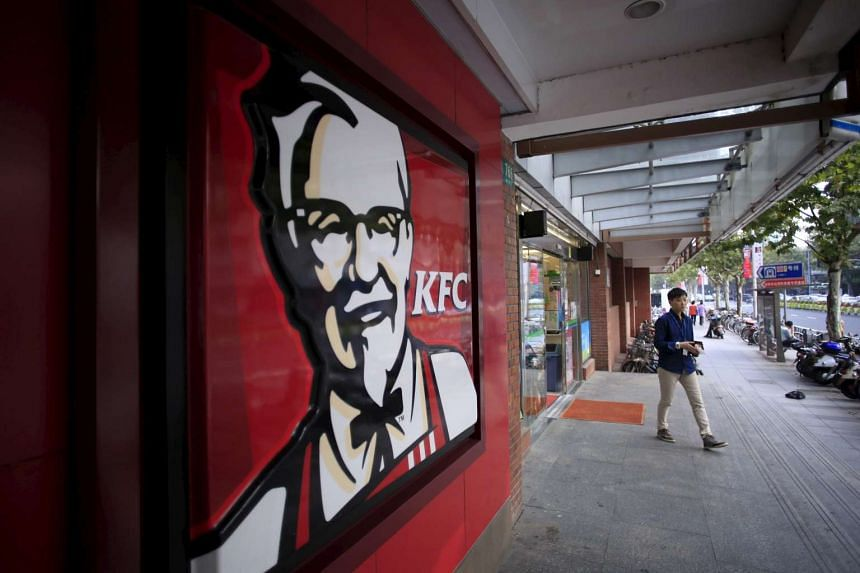 A customer walks out of a KFC restaurant in Shanghai, China, on Oct 9, 2015.