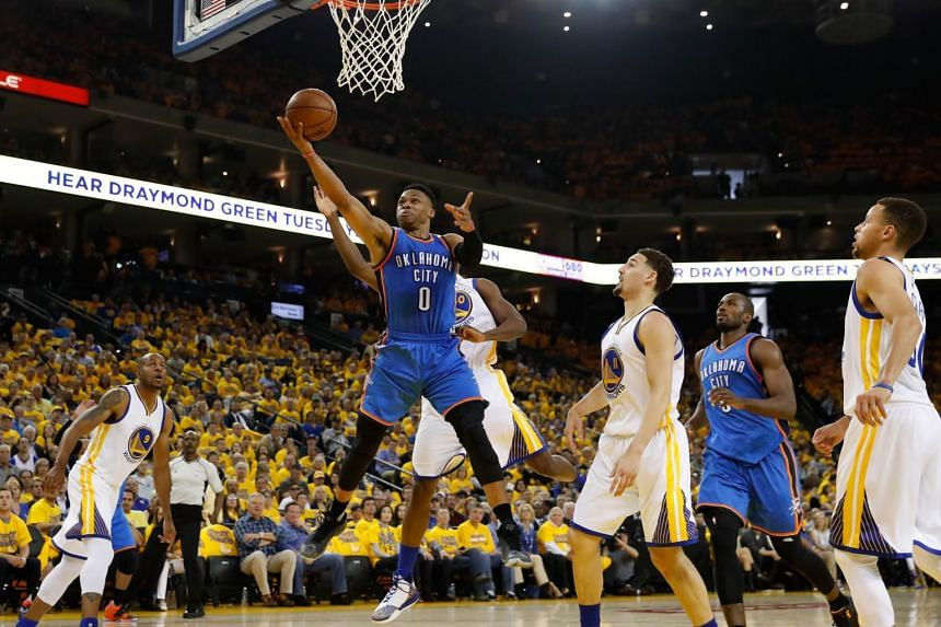 Russell Westbrook #0 of the Oklahoma City Thunder goes up for a shot against the Golden State Warriors during game one of the NBA Western Conference Final at ORACLE Arena on May 16, 2016 in Oakland, California.
