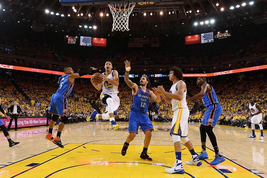 Stephen Curry #30 of the Golden State Warriors goes up for a shot against the Oklahoma City Thunder during game two of the Western Conference Finals during the 2016 NBA Playoffs at ORACLE Arena on May 18, 2016, in Oakland, California.