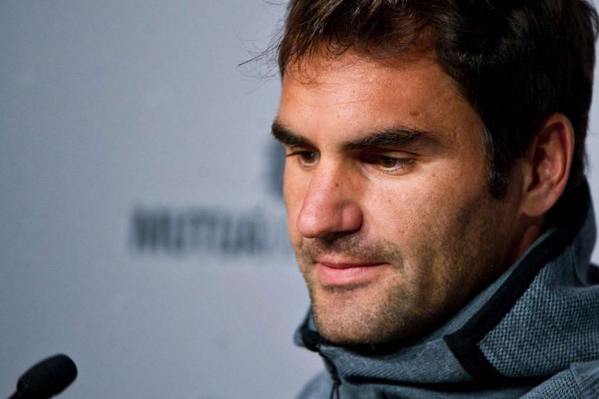 Federer (above) has failed to recover from a back injury.