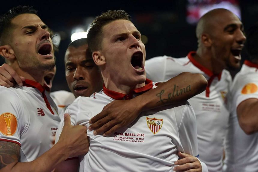 Sevilla's French forward Kevin Gameiro celebrates after scoring.
