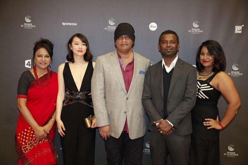 K. Rajagopal (center) and cast members of A Yellow Bird - (from left) Seema Biswas, Huang Lu, Sivakumar Palakrishnan and Udaya Soundari.