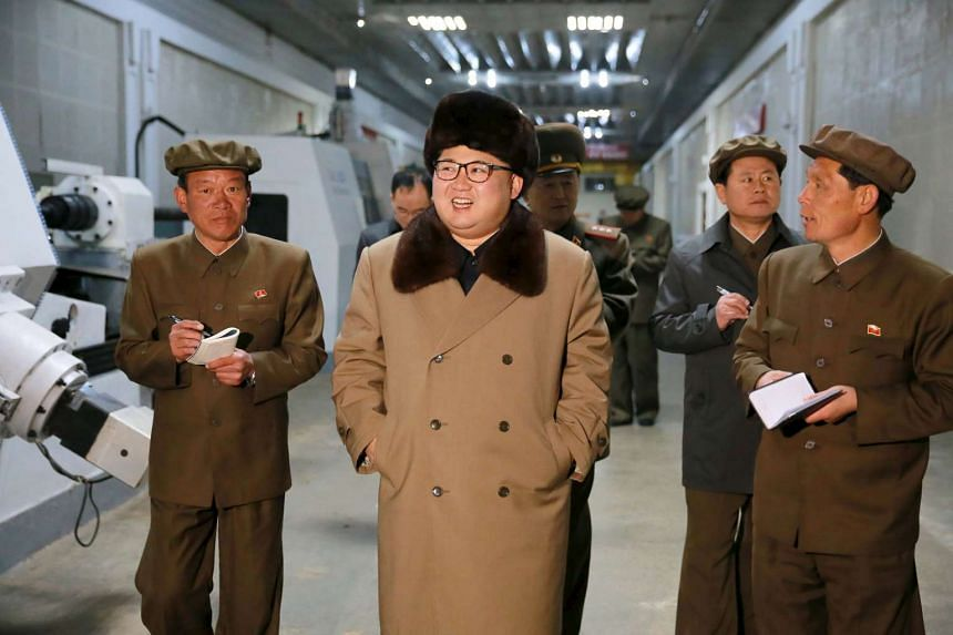 North Korean leader Kim Jong Un (centre) at the Tonghungsan Machine Plant in this undated photo released by North Korea's Korean Central News Agency (KCNA).