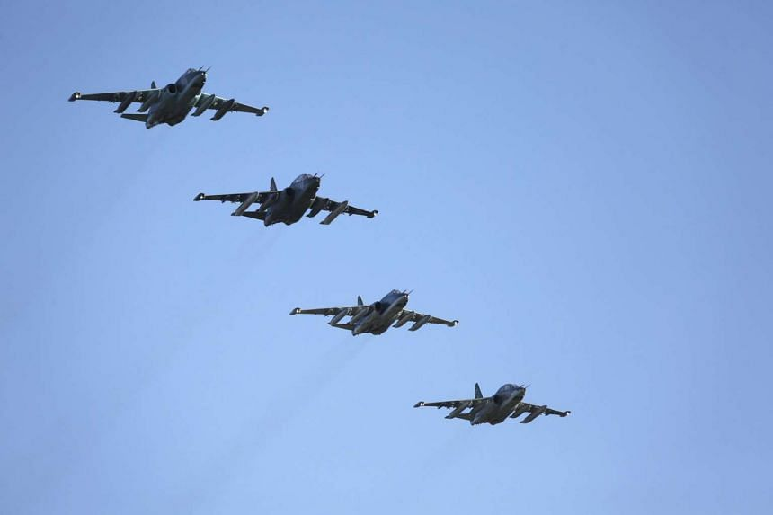 Russian fighter jets fly in formation after returning from Syria, before landing at an airbase in southern Russia, on March 16, 2016.