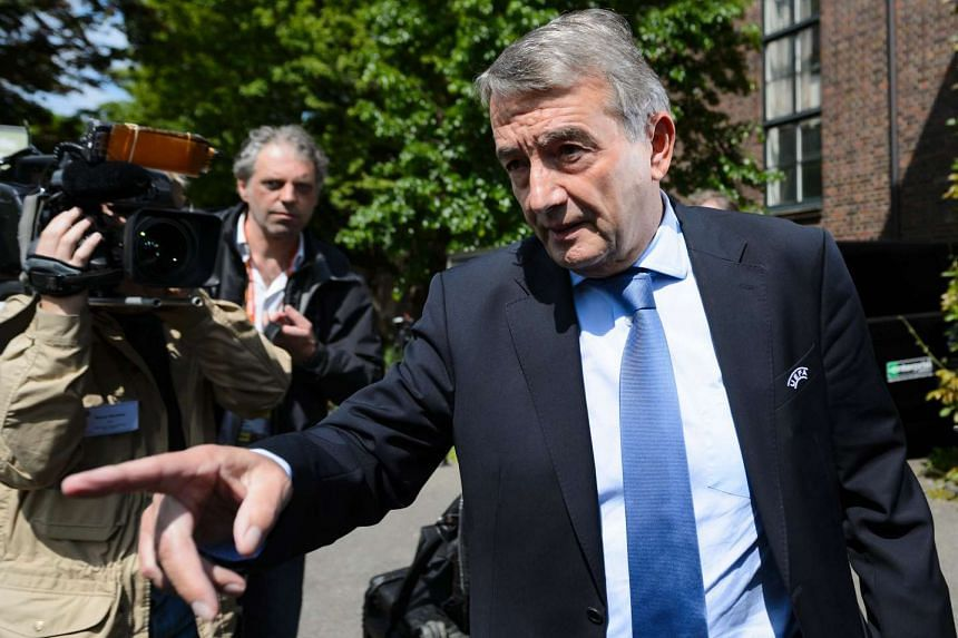 Former president of the German Football Association Wolfgang Niersbach gestures after leaving a meeting in Basel, on May 18, 2016.