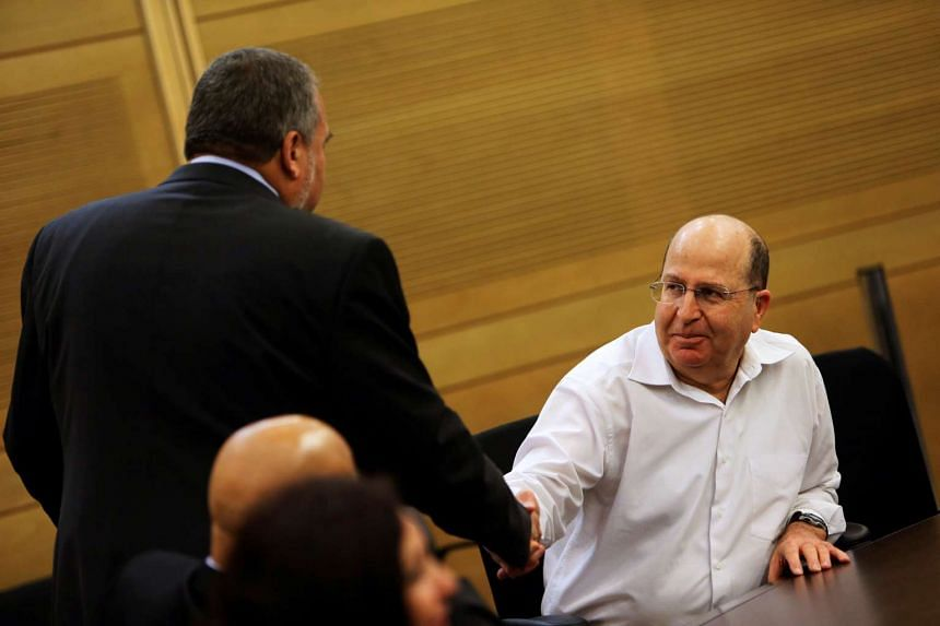 Moshe Yaalon (right) at a Likud-Beiteinu party meeting at the Knesset, the Israeli parliament, on March 14, 2013.