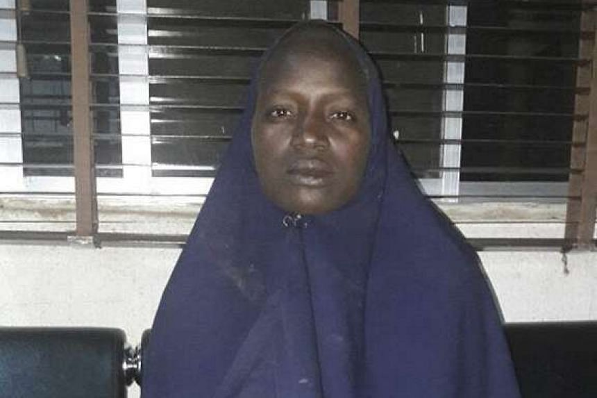 A handout photograph provided by the Nigerian Military, showing rescued Chibok girl Serah Luka at Damboa Local Government Area of Borno State, on May 19, 2016.