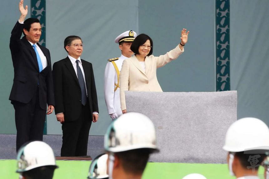Taiwan's new president Tsai Ing-wen (right) and former president Ma Ying-jeou (left) waving to the crowd in Taipei, on May 20, 2016.