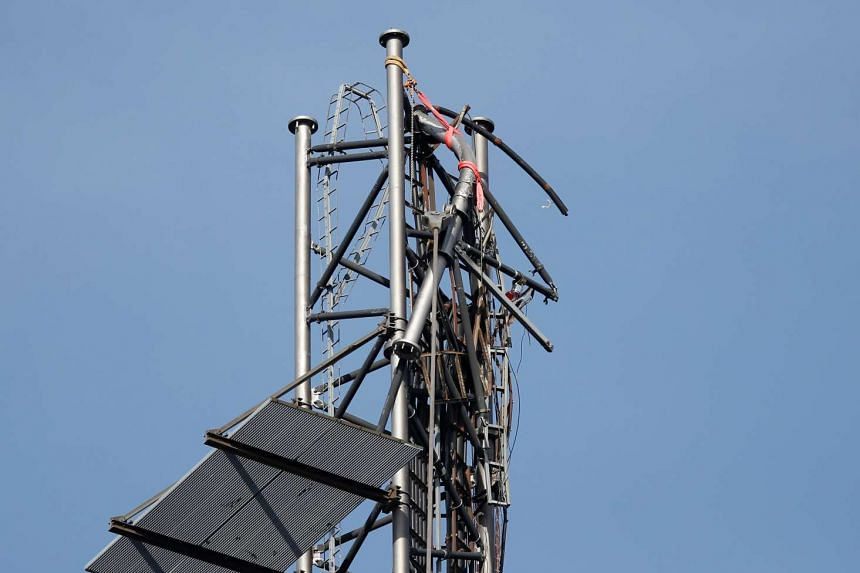 The broken top of a 300m-high telecom mast is seen outside Boras, Sweden, on May 17, 2016.