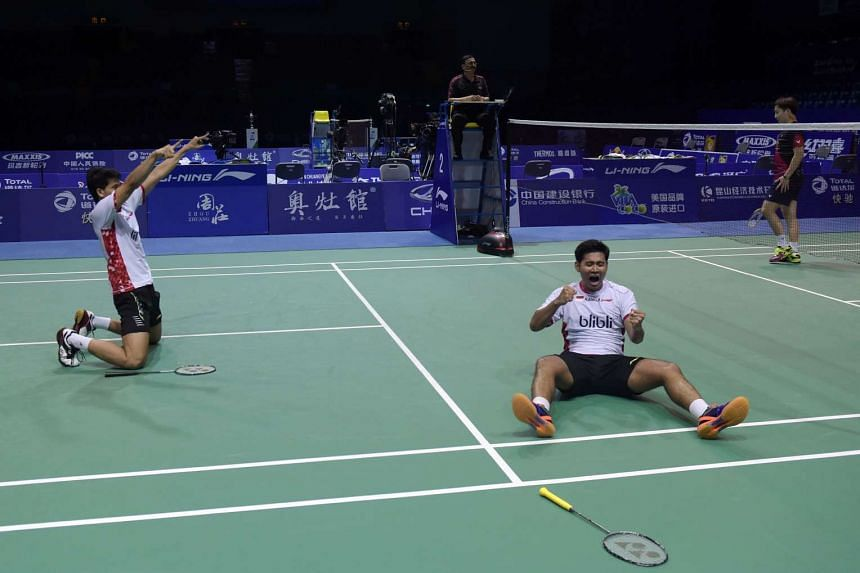 Angga Pratama (right) and Ricky Karanda Surwardi of Indonesia celebrate their victory in the men's semi-finals group match at the Thomas Cup tournament in Kunshan, on May 20, 2016.