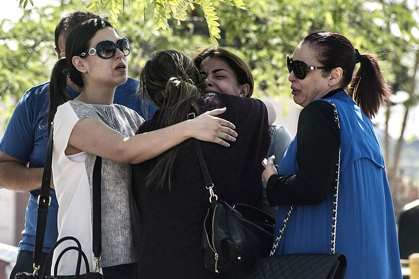 Anxious relatives of passengers aboard the EgyptAir plane waiting for news at the Cairo airport yesterday. Flight MS804, which had 66 people on board and was heading to Cairo from Paris, did not make any distress call before it went down.