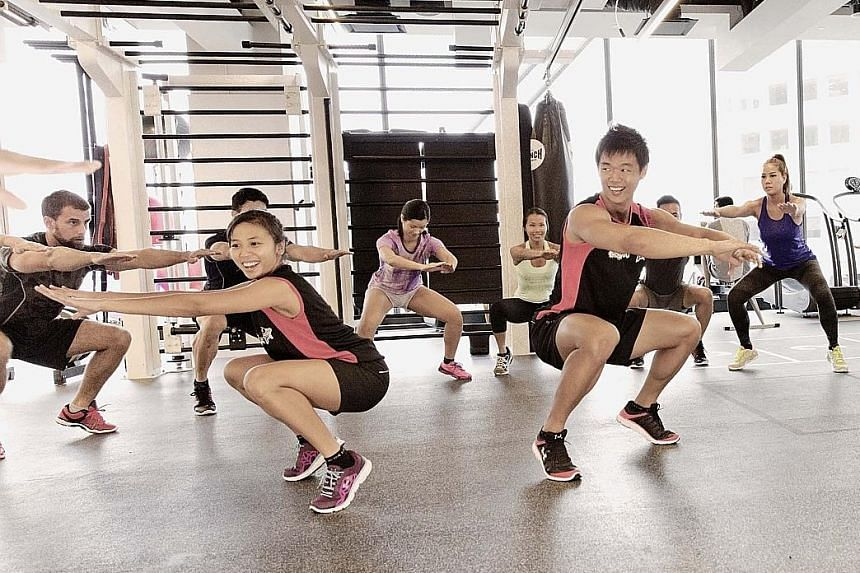 Virgin Active club members participating in a high-intensity interval training workout.