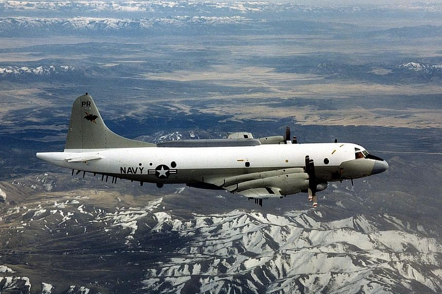 An undated picture provided by the US Department of Defence shows a US Navy EP-3 flying over an unknown location. Two Chinese fighter jets flew within 15m of a US EP-3 plane on Tuesday.
