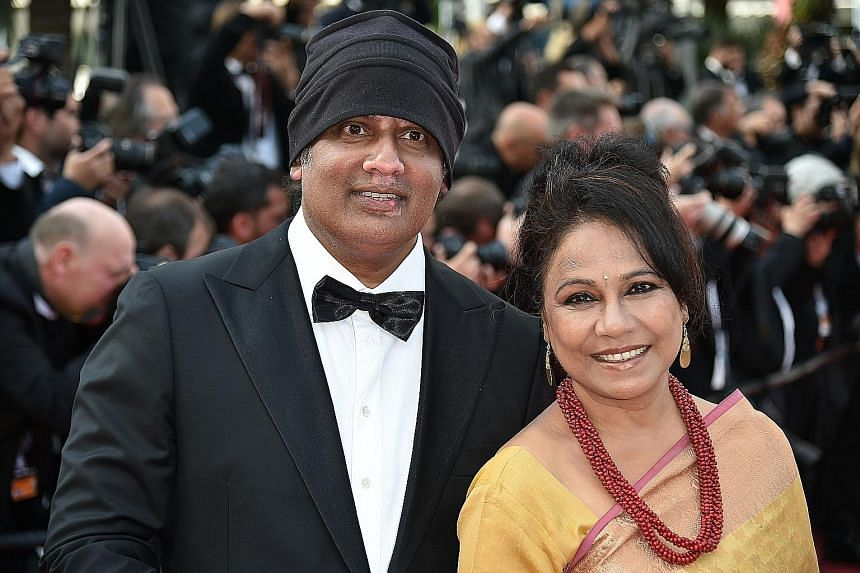 Singaporean director K. Rajagopal (with Indian actress Seema Biswas) at the Cannes Film Festival, where his movie, A Yellow Bird, premiered on Wednesday.